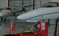jets in hangar waiting line services